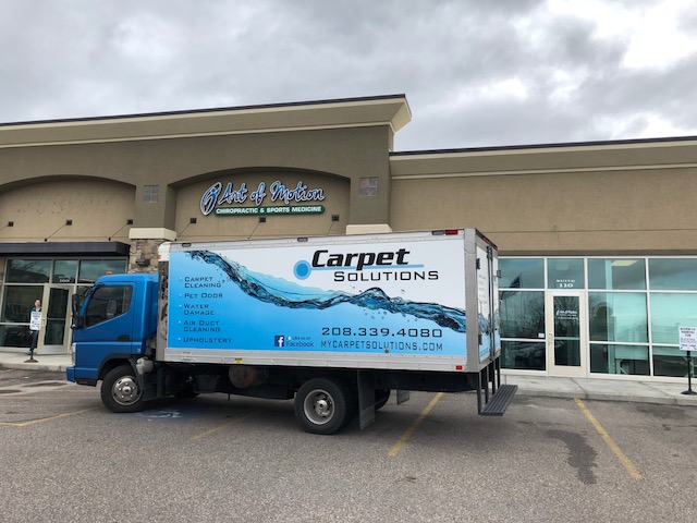 Carpet Solutions uses truck mounted hot water extraction